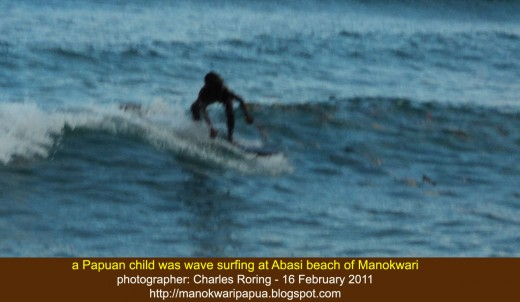 a Papuan child was wavesurfing at Abasi beach near Manokwari city of West Papua