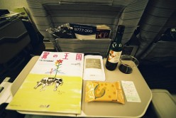 In-Flight Magazine & Red Wine. Photo by Hyougushi (flickr)