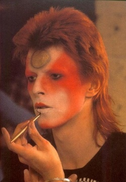 David Bowie putting on his stage make up!