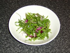 Preparing the Red Onion and Rocket Salad