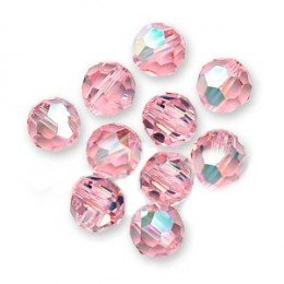 Pink rhinestones that peel off and stick to ribbon, flowers etc.