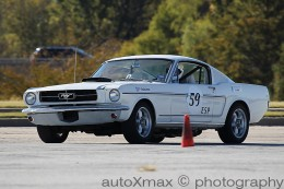 A mid-60's Ford Mustang autocrossing