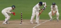 Sachin Tendulkar glides the ball down to third man as the wicketkeeper and a fielder looks on