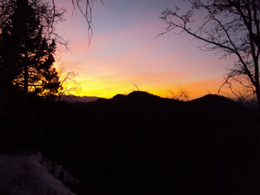 Sunset with snow in the foreground.  Tangerine colors in the sky are quite captivating.