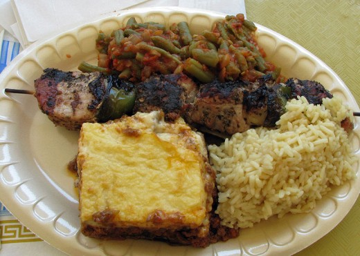 Mousaka - (bottom center) Yahni (String Beans - top center) Pork Souvlaki (Kebab) - (left to right, center Rice Pilaf - (bottom right)