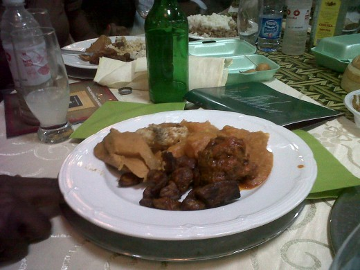 yam porridge with fried fish, plantain, cow meat and delicious moi moi