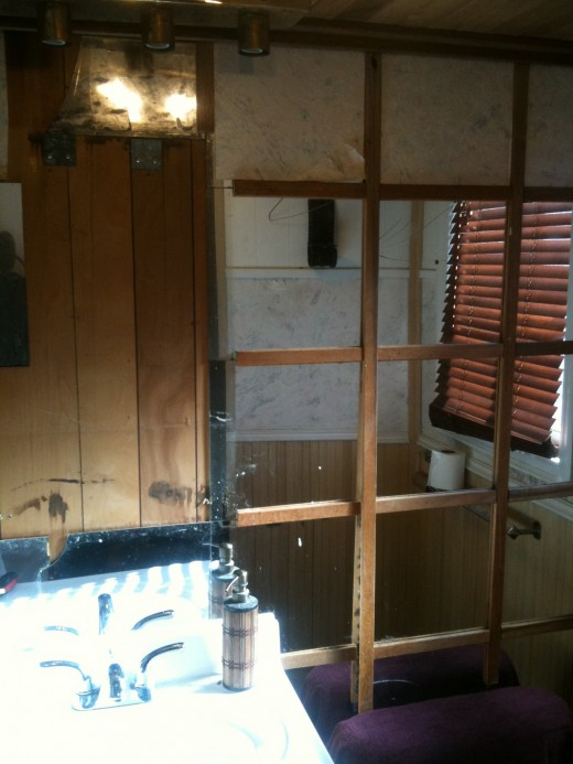 The incredible tile mirrors in my bathroom.  In this shot the 1970s vanity has already been taken down.  Ugh.