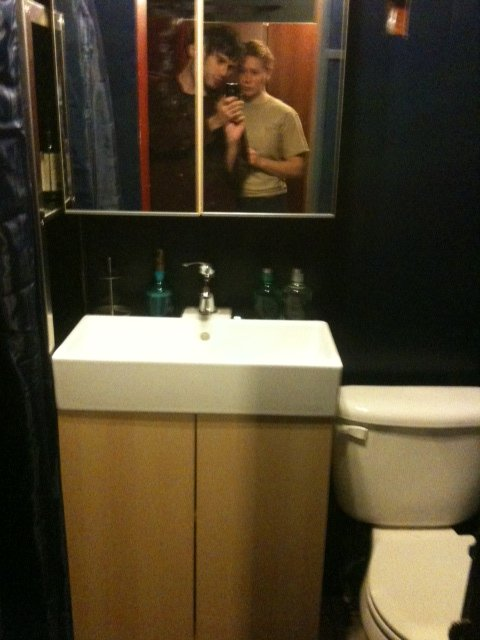 Our new bathroom!  That's Hana and I reflected in the picture, admiring our work :)
