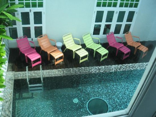I think these colourful deck chairs add a delightful accent to the room. Image: New Majestic Hotel