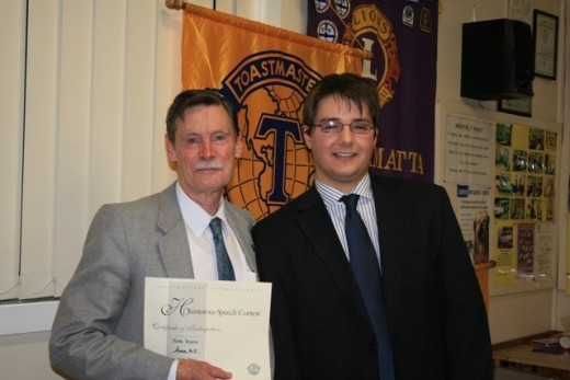Writer receiving a certificate at Area 45 Contest in 2009.