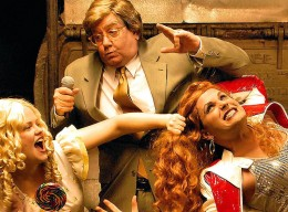 Emily Grundstad (left) as Baby Jane, Mike Cornelison (center) as Jerry, Mark Maddy (right) as Tremont in StageWest's production of Jerry Springer, The Opera.