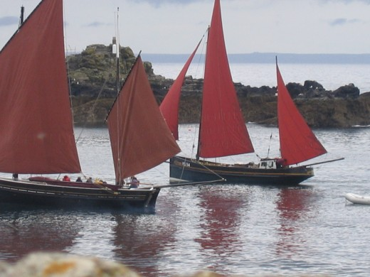 Old sailing luggers off St Clement's Isle, Mousehole.