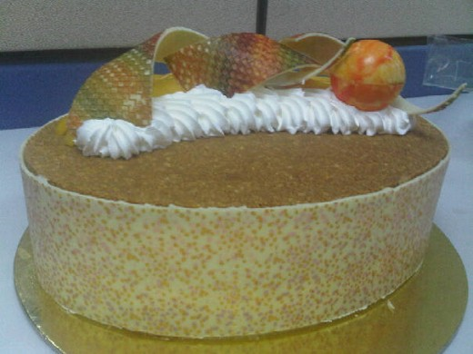 beautifully decorated mango cake