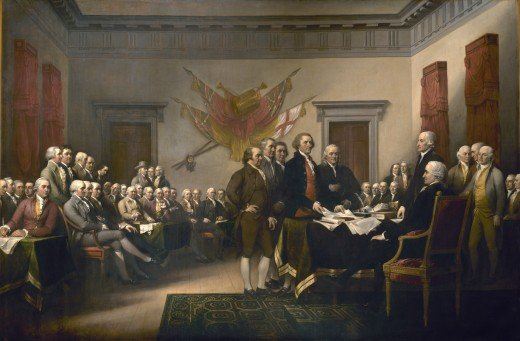In John Trumbull's painting Declaration of Independence, the five-man drafting committee is presenting its work to the Continental Congress. Jefferson is the tall figure in the center laying the Declaration on the desk.