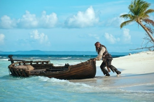 Jack Sparrow is trying to get away from a precarious situation in Caribbean @ Pirates 4 movie wallaper
