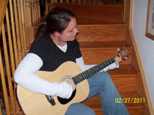 Learning how to play guitar... start off with baby steps. Or you can just pose with a guitar and act like you are cool while strumming!
