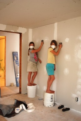 Our daughter and one of her friends sanding her walls
