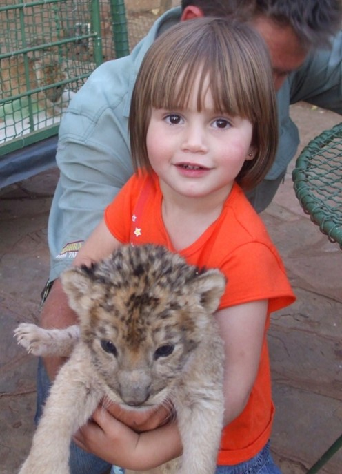 Granddaughter Mia Cilliers holding a lion cub