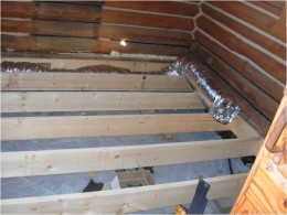 Day 8 - Floor joists on back wall and right side of room