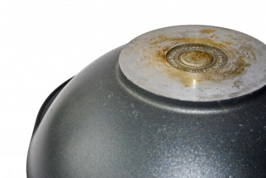A wok has a narrow or rounded bottom, and wide sides for pushing food around.