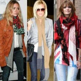 Three attractive females all wearing long scarves