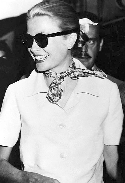 Grace Kelly wearing a small scarf around her neck