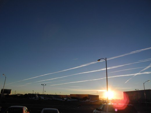 Pencil Thin Chemtrails Glistening in the Morning Sun like a freshly created Spider's Web (later morph into the HUGE Chemical Clouds shown in the 1st two pics).