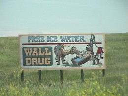 There is one of these with different messages about Wall Drug about every 10 miles on Interstate 90.