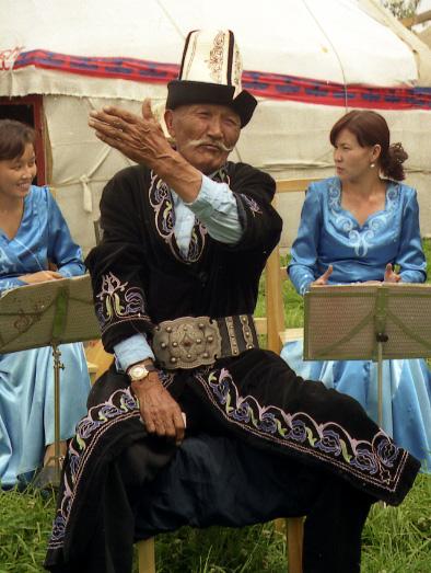 Kyrgystan-cultural performers in traditional dress