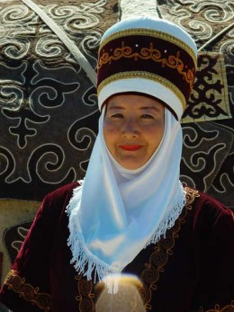 Lady dressed up in traditional clothes. In day to day life most people wear western clothes in Bishkek.
