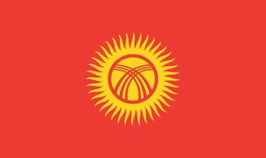 The Flag of Kyrgystan shows the 40 rays of the sun and the wooden cross supports at the top of the yurt