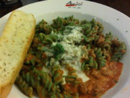 Fusili pasta goes very well with tomato sauce and meat, topped with parmesan cheese and a slice of bread on the side.
