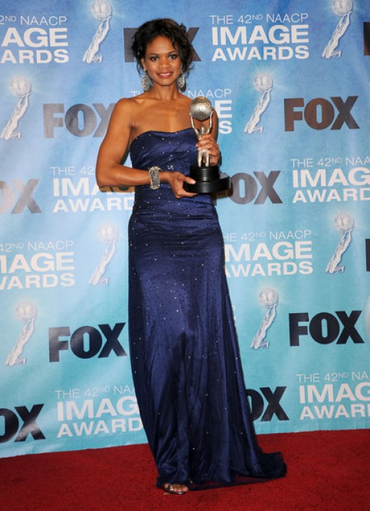 Kimberly Elise in the press room at the 42nd Annual NAACP Image Awards. photo credit: zimbio.com