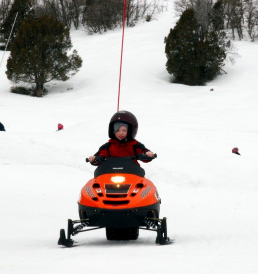 Snowmobiling for kids at Gorgoza Park