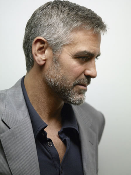 Here we see Clooney change things up and go with a light gray corduroy blazer