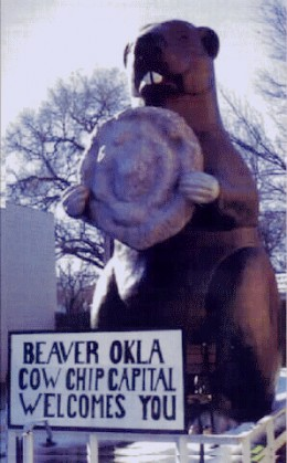 It's a giant beaver holding a cow chip. Duh.