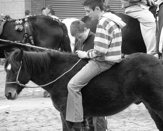Ready to ride: A teenage 'urban cowboy' sits bareback on his pony in Smithfield