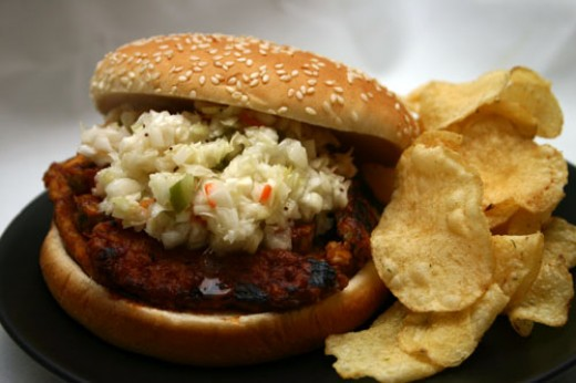 Barbecue tempeh sandwich with cold-slaw and potato chips