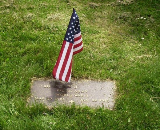 Grave of a Veteran decorated with a flag on Memorial Day