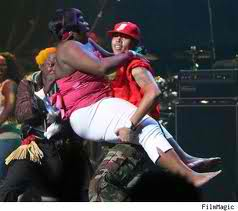 Chris Brown as a loyal fan attacks him. Be careful Chris.