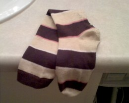 Sock that matches this sock missing since October 2010.  Its twin sock misses it very much.  Please contact if seen.  No questions asked.     Description: brown, tan, and pink striped knee high sock.  Looked adorable with brown flats.