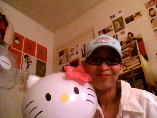 This is me wearing my Hello Ktty baseball cap and holding my Hello Kitty doll.