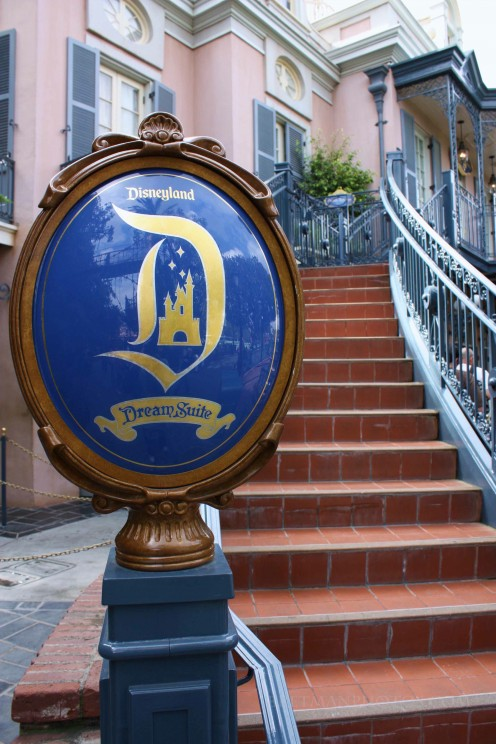 A curving brick staircase beckons guests up to the Disney Dream Suite.