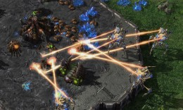 This is a screenshot from Starcraft 2, showing one player's mining operations being attacked by his opponent.