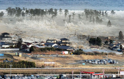 This dramatic Mar 11, 2011 tsunami photo shows 33 foot waves breaking over the tops of shoreline trees. The water continued inland for several kilometers destroying everything in its path.