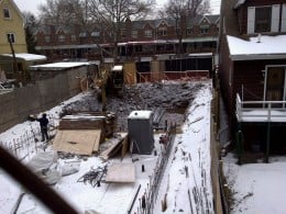 Excavation carried on in between homes on quiet residentail street.