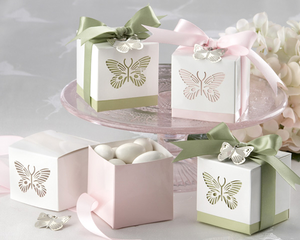 Fill pretty wedding favor boxes with candy for a diy favor.