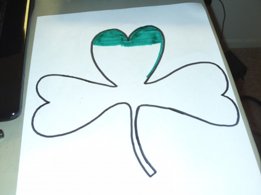 I began coloring in the top leaf of my shamrock with a green marker.