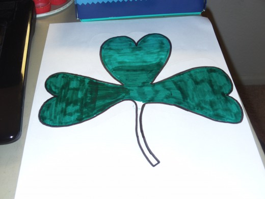 I have colored the top three leaves, and now I need to color the stem.