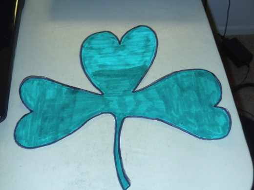 I carefully cut out my large Saint Patrick's Day shamrock decoration.
